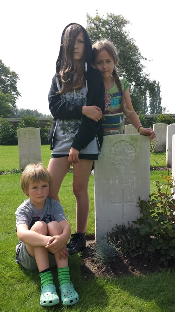 Ella, Lottie and Kai at Charles' grave in Ypres